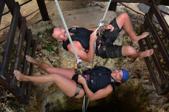 Repelling down a cenote.